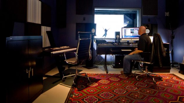Photo of Audio Engineer in the recording studio at the IMRC Center