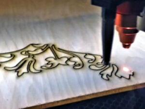 Laser Cutting Logo into Wood